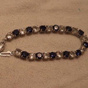 Jewelry - Sapphire, white topaz and white gold bracelet.